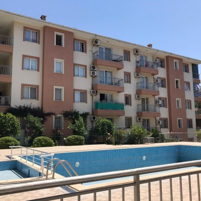 Kusadasi behind the garage 2 + 1 pool, security site apartment for sale