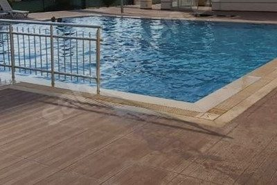 2+1 100m2 1st floor apartment for sale with pool and security in the center of Kusadasi, close to everywhere